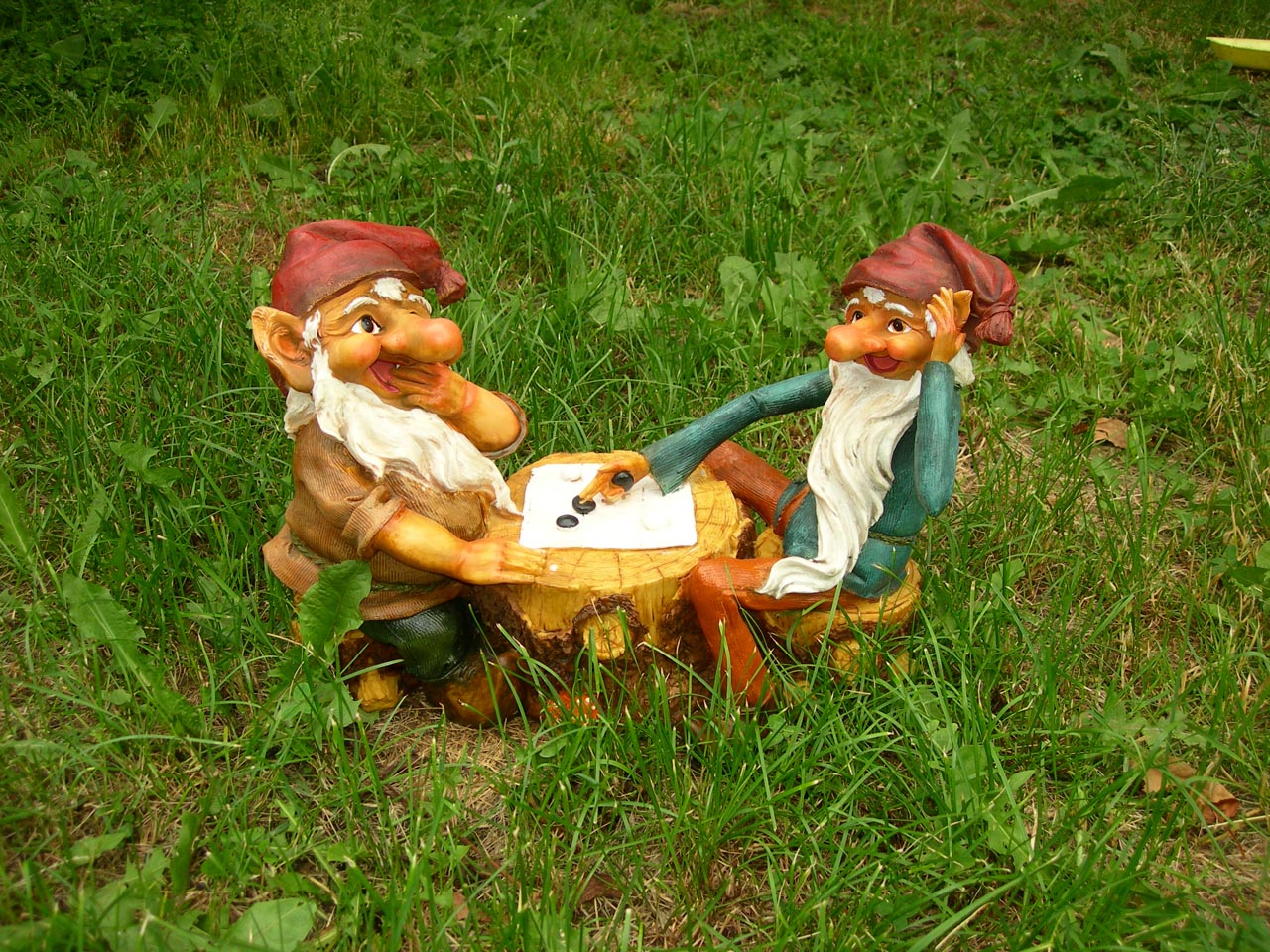 Two Garden Gnomes Playing Checkers